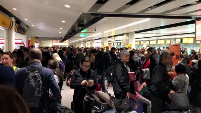 queues form at gatwick airport on thursday, december 20, after drones force flight cancellations and runway closures. - ガトウィック空港点の映像素材/bロール