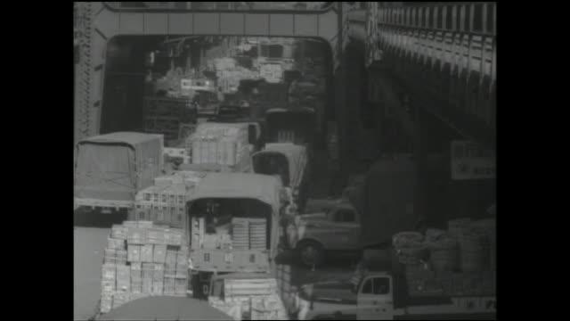 queues of cargo laden trucks crowd a street near the akihabara railway station. - akihabara station stock videos and b-roll footage