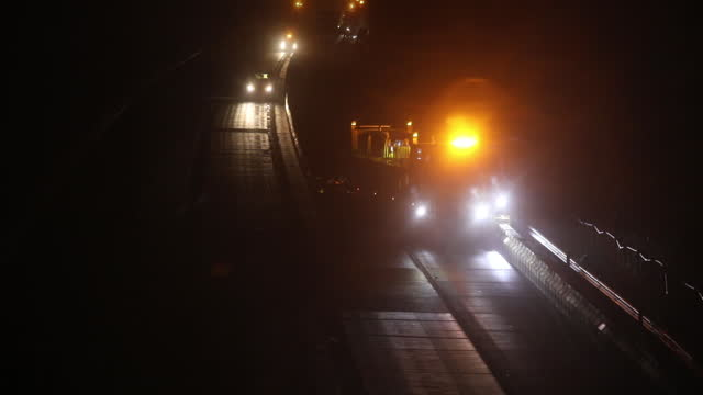 queues of lorries for the port of dover on the m20 and operation brock practice on the m20 motorway, a temporary barrier being placed prior to brexit... - articulated lorry stock videos & royalty-free footage