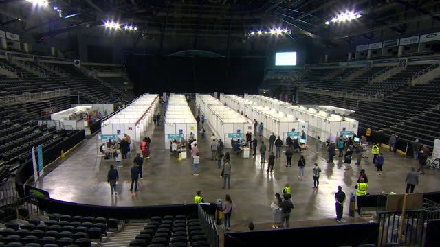 queues of people waiting to get their covid-19 vaccine at the mass vaccination centre at the sse arena in belfast - belfast stock videos & royalty-free footage