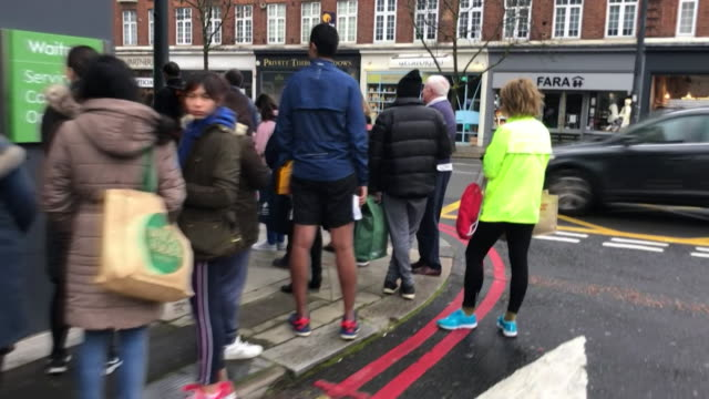 queues outside supermarket in london as people panic buy during coronavirus pandemic - queuing stock videos & royalty-free footage