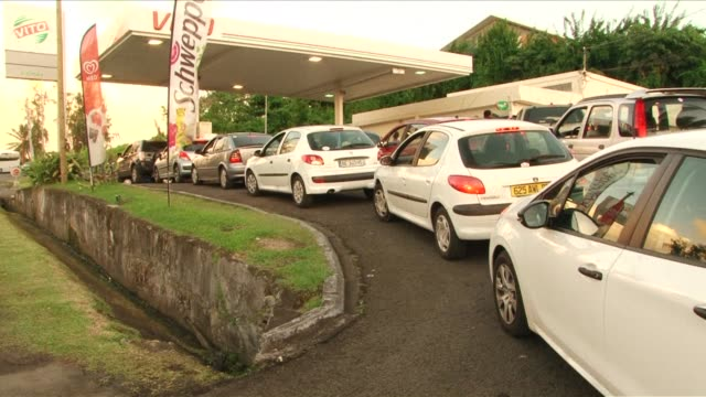 queuing cars in front of gas stations cause traffic jams in martinique as gas station owners call for an 'unlimited strike' after talks with the... - french overseas territory stock videos & royalty-free footage
