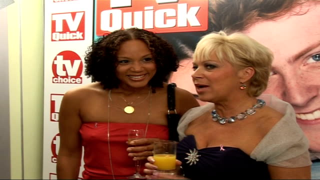quick and tv choice awards: celebrity interviews; england: london: dorchester hotel: int side view angela griffin, wearing red strapless dress, and... - strapless stock videos & royalty-free footage