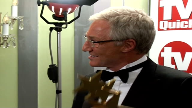 paul o'grady interview england london dorchester hotel int side view paul o'grady holding award speaking to press - paul o'grady stock-videos und b-roll-filmmaterial