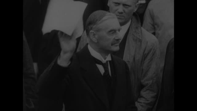 quick shot british prime minister neville chamberlain signing document in munich / chamberlain stepping out of british airways plane at heston... - 1938 stock-videos und b-roll-filmmaterial