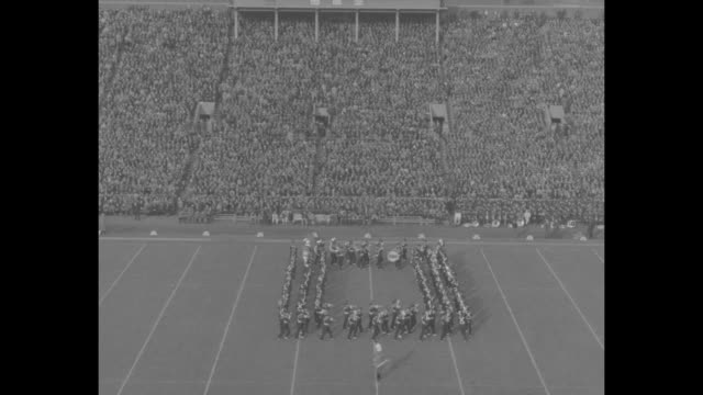 quick shot game action in ohio stateminnesota college football game / ohio state's marching band performs on field of memorial stadium during... - marching band stock videos & royalty-free footage