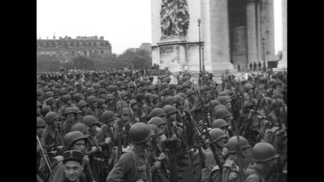 quick shot military parade down champs-elysees with row of jeeps, military journalist with movie camera in street, crowds to the sides, can see... - arc de triomphe paris stock videos & royalty-free footage