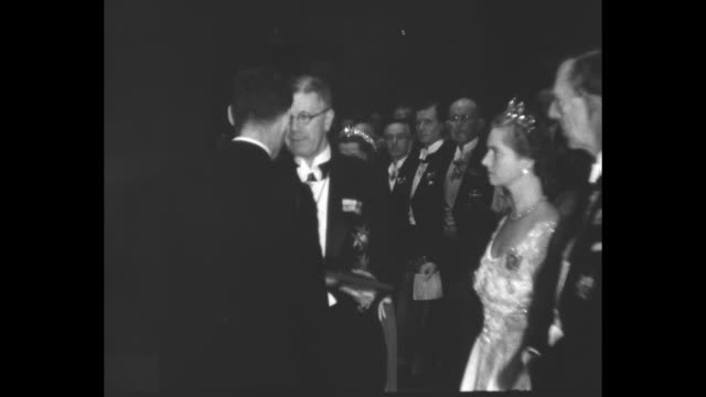 quick shot sweden's crown prince gustaf adolf speaks with award winner / audience members applaud / poet t s eliot bows after receiving his nobel... - nobel prize in literature stock videos & royalty-free footage