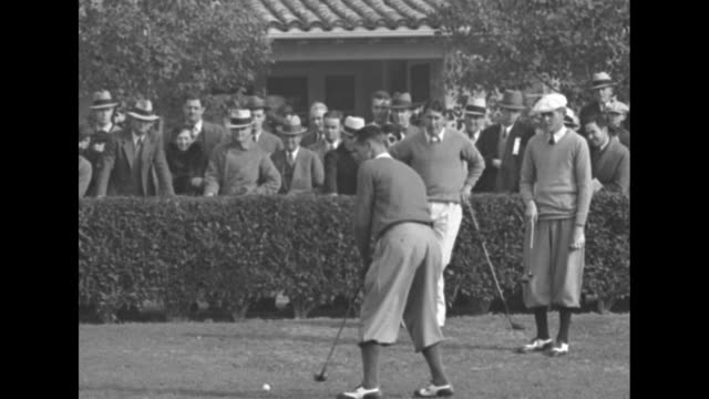 """quick shot title card: """"white plains boy victor in pasadena open -paul runyan beats country's best golfers in big tourney"""" / denny shute making... - pgaイベント点の映像素材/bロール"""