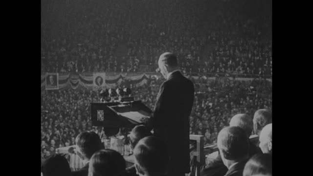 coolidge back in politics returning to public life with stirring plea for hoover he may 'choose to run' in 1936 / vs shots of the packed arena /... - herbert hoover us president stock videos & royalty-free footage