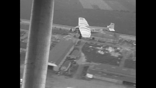 drop freight from sky on parachute airplane truck tries out newest method of quick delivery in test at curtiss field / pan of men with a monoplane /... - airplane tail stock videos and b-roll footage