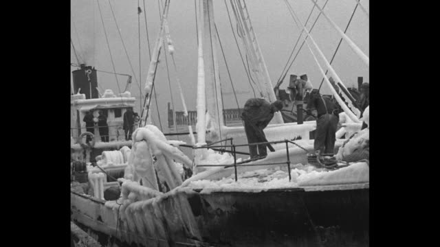 vídeos de stock, filmes e b-roll de sea blasts etch trawlers in ice east boston mass back from grand banks fishermen clear ships of crystal coat a foot thick / vs crew members chopping... - ice crystal