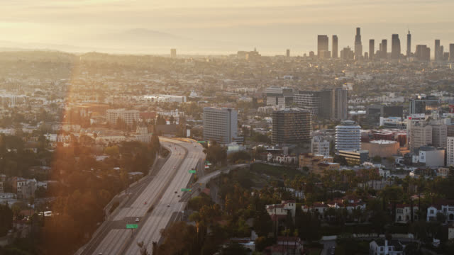 quiet 101 freeway with hollywood and dtla at sunrise - aerial - downtown stock videos & royalty-free footage