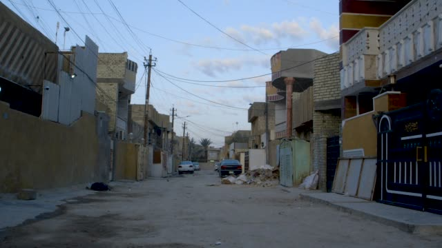 quiet baghdad street, wide shot - iraq stock videos & royalty-free footage