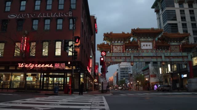quiet chinatown is seen april 1, 2020 in washington, dc. the district of columbia has joined other states and territories, including neighboring... - maryland stato video stock e b–roll
