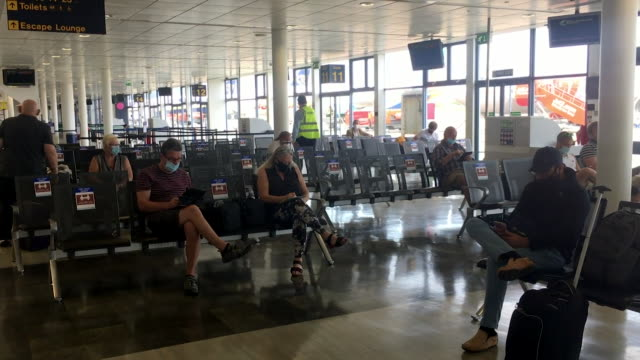 quiet east midlands airport departure lounge as tourist flights begin to spain as the country reopens its tourism sector after coronavirus lockdown - gate stock videos & royalty-free footage