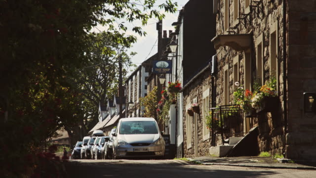 quiet english village street - stationary stock videos & royalty-free footage