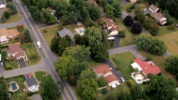 AERIAL: Quiet luxury suburban town with spacious exquisite houses in lush nature