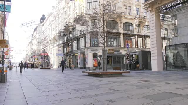 quiet street during covid-19 curfew, vienna, austria - austria stock videos & royalty-free footage