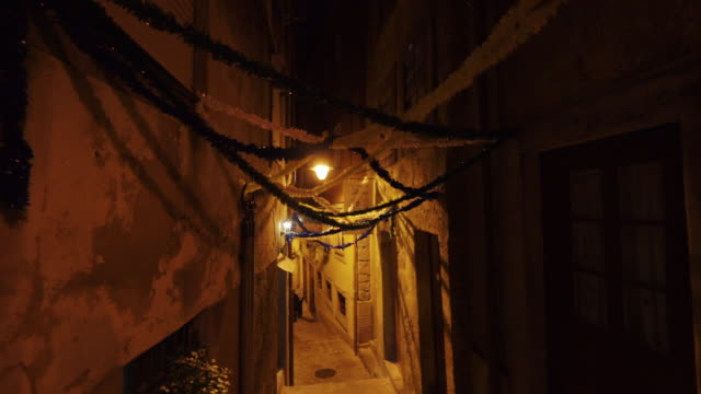quiet street in porto, portugal at night - alley stock videos & royalty-free footage