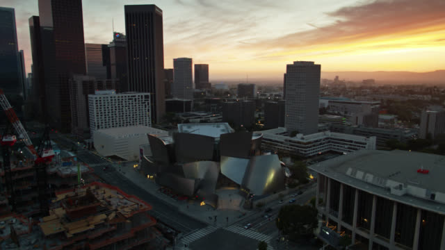 quiet streets around walt disney concert hall in downtown los angeles during covid-19 lockdown - aerial - disney stock videos & royalty-free footage