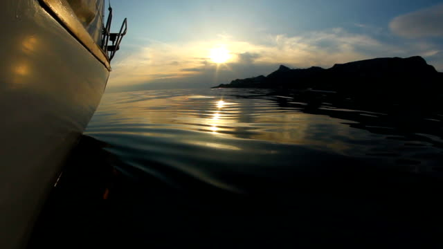 quiet sunset on a yacht at sea