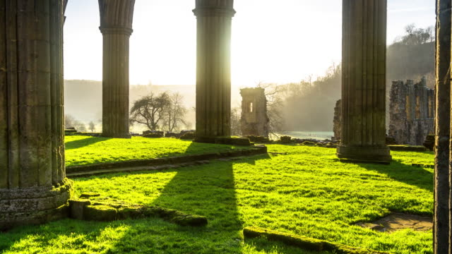 quiet wintry day in ruined english abbey - time lapse - abbey stock videos & royalty-free footage