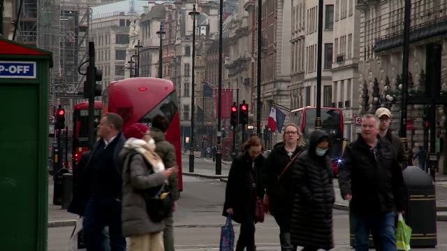 quieter street scenes in central london and people wearing face masks as people during the coronavirus pandemic - silence stock videos & royalty-free footage