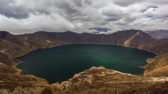 quilotoa lake, a water filled volcanic caldera in the ecuadorian andes - ecuador stock videos & royalty-free footage