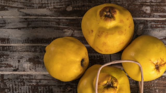 quince fruits on the wood background - quince stock videos & royalty-free footage
