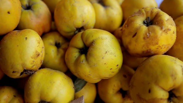 quince in the marketplace,close up - quince stock videos & royalty-free footage