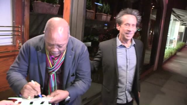 quincy jones brian grazer greet fans while departing madeo in west hollywood 02/28/13 - quincy jones stock videos & royalty-free footage