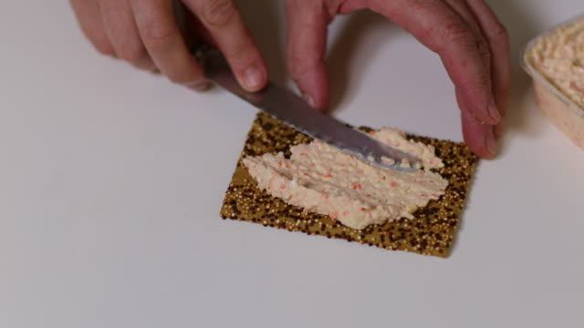 quinoa rye cracker with crab salad. - cracker stock videos and b-roll footage