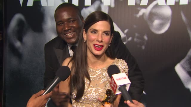 quinton aaron and sandra bullock at the 2010 vanity fair oscar party hosted by graydon carter at west hollywood ca. - academy awards stock videos & royalty-free footage