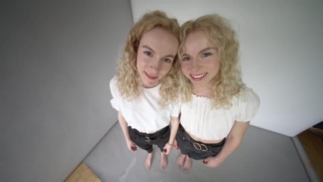 quirky studio portraits of identical twin sisters. - identical twin stock videos & royalty-free footage