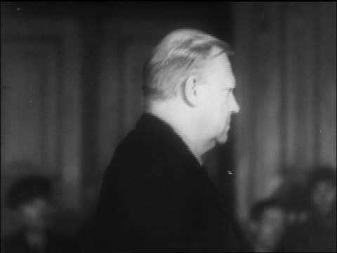 quisling standing in courtroom during war crimes trial / newsreel - only mature men stock videos & royalty-free footage