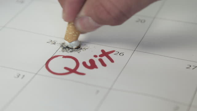 quit smoking with monthly calendar - cigarette stock videos & royalty-free footage