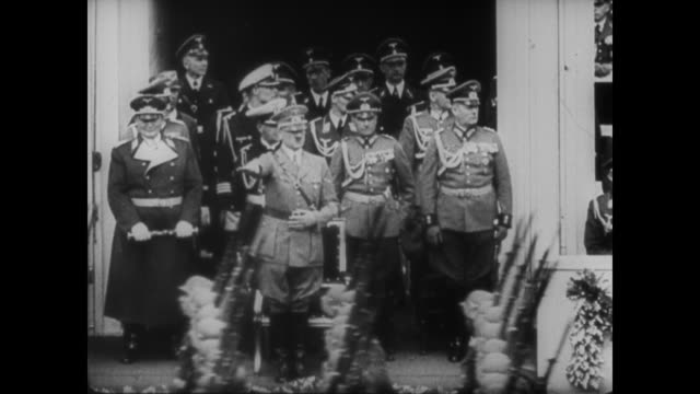 "quote appears on the screen: ""i am willing to sign anything. i will do anything to facilitate the success of my policy,"" adolf hitler, 1933 - nazism stock videos & royalty-free footage"