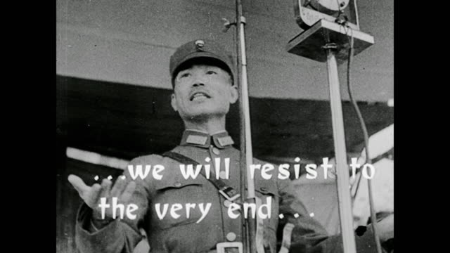 "quote appears on the screen: the whole nation must rise as one man and fight these japanese bandits."" generalissimo chiang kai-shek - mao tse tung video stock e b–roll"