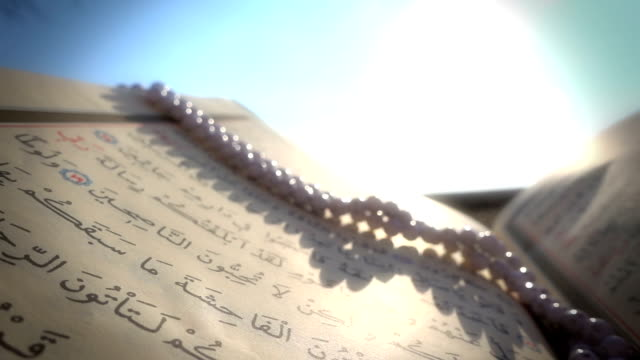 quran,prayer beads and sunset - koran stock videos and b-roll footage