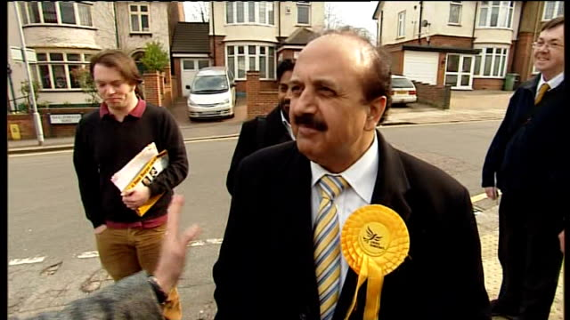 Qurban Hussain interview SOT Qurban Hussain giving woman Lib Dem sign to put in her window Nigel Huddleston discussing expenses scandal with young...