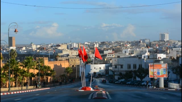 rabat morocco traffic outdoors on road in city center with flags - street name sign stock-videos und b-roll-filmmaterial