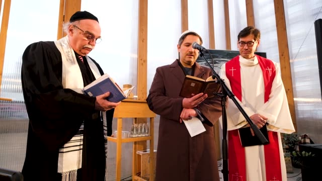 rabbi andreas nachama , imam kadir sanci and protestant priest gregor hohberg speak at the finissage of the house of one temporary structure on... - priest stock videos & royalty-free footage