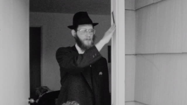 rabbi samuels kissing the mezuzah on his doorpost / rabbi praying from siddur / wrapping tefilin phylacteries / praying with talit shawl / chabad... - judaism stock videos & royalty-free footage