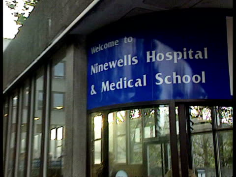 rabies confirmed in scottish wildlife worker grampian = no resale dundee ninewells hospital ext sign above entrance to hospital where mcrae is being... - rabies stock videos & royalty-free footage
