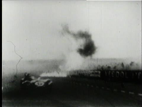 vídeos de stock e filmes b-roll de montage race car crashing into the crowd injuring and killing numerous spectators / le mans france - 1955