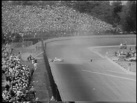 b/w 1966 race car crashing into wall on track at indy 500 as cars swerve to avoid tire / newsreel - wreck stock videos & royalty-free footage