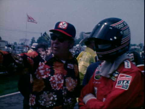 race car driver brian redman talking with unidentified man in pits midohio sports car course / race car driver jody scheckter standing talking in... - mustang convertible stock videos & royalty-free footage