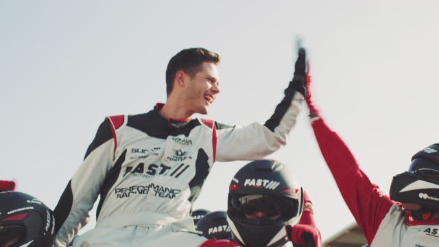 race car driver celebrating success with team - winning stock videos & royalty-free footage