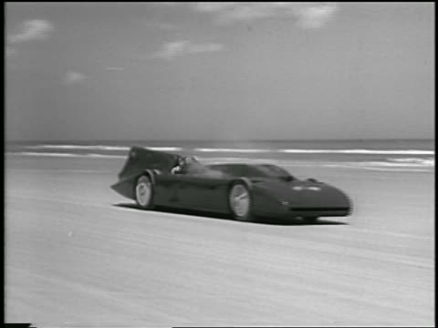race car driver driving experimental race car on daytona beach - 1935 stock videos & royalty-free footage